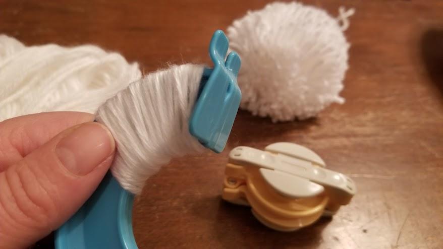 wrapping yarn to make pom pom garland