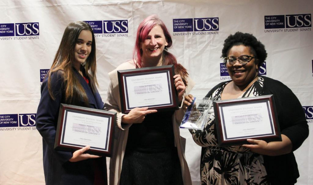 Kiosk members: Yerelyn Nunez, Lisa Sheridan, and Milan Fredricks with awards