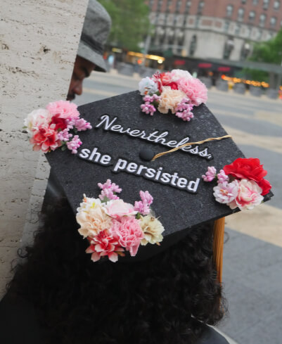 cap at graduation decorated with nevertheless she persisted