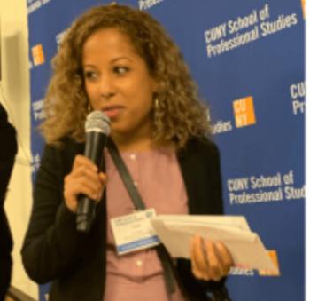 Tara Santos speaks at an assembly
