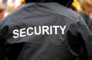 bigstock-Security-Guard-Back-6008755-300x196
