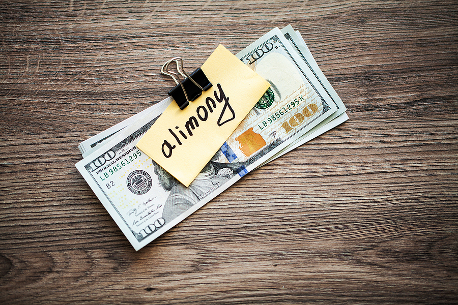 bigstock-Payments-Alimony-Pile-Dollars-310576339