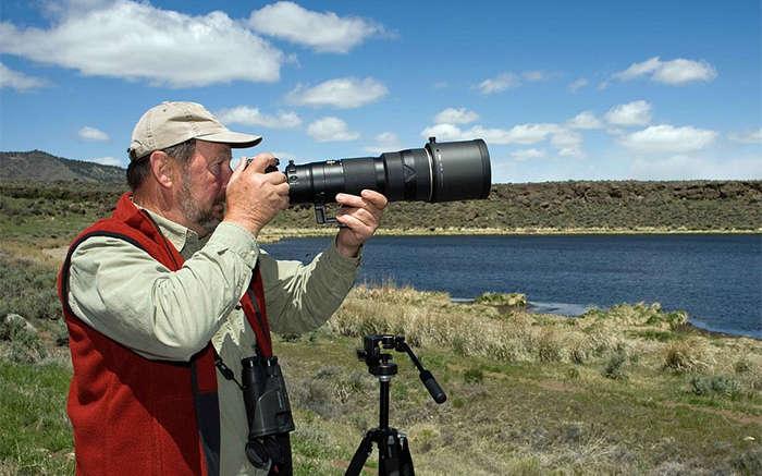 man using best camera gear landscape
