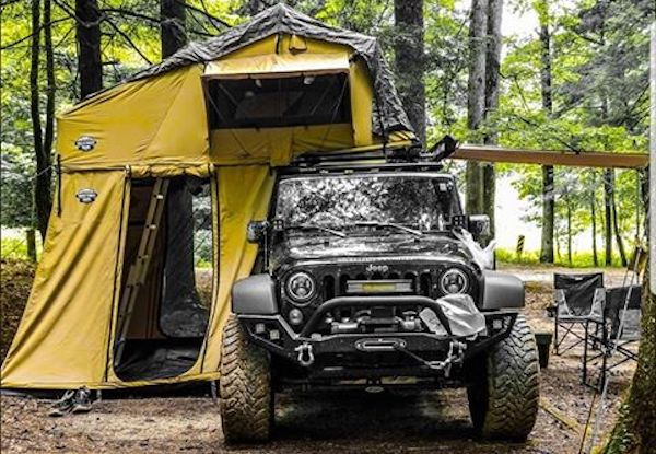 black jku jeep with cvt roof top tent annex and awning