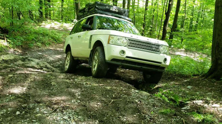 overland range rover with roof top tent