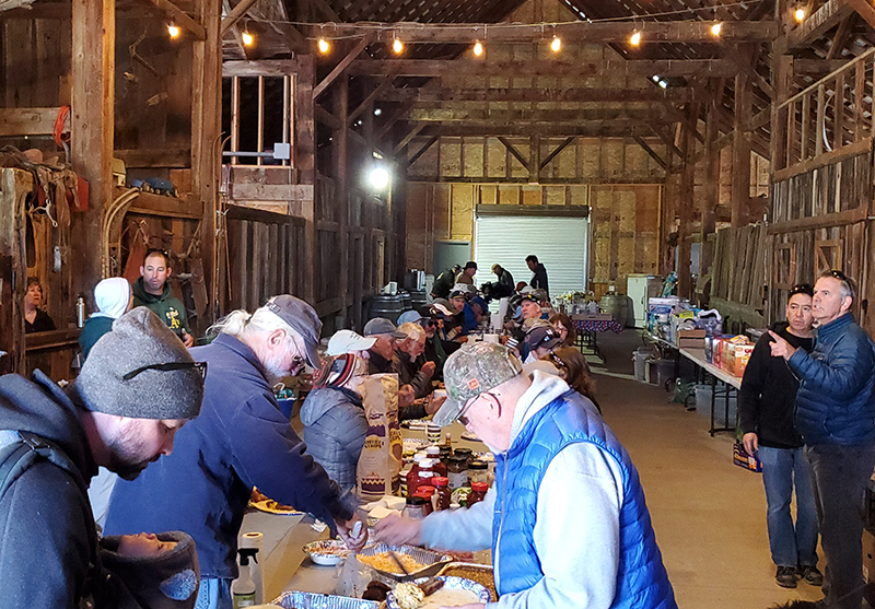 eating breakfast in diamond s ranch barn