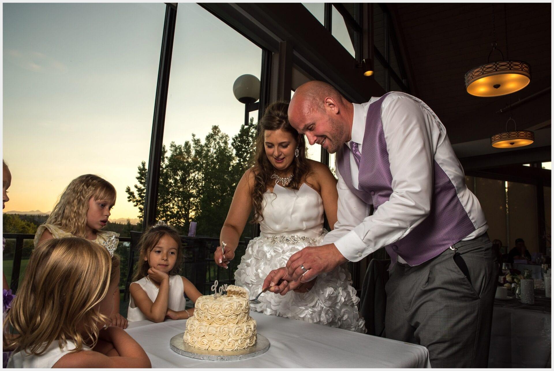 011-Wedding Cutting Cake_Priddis_Calgary_Photography-