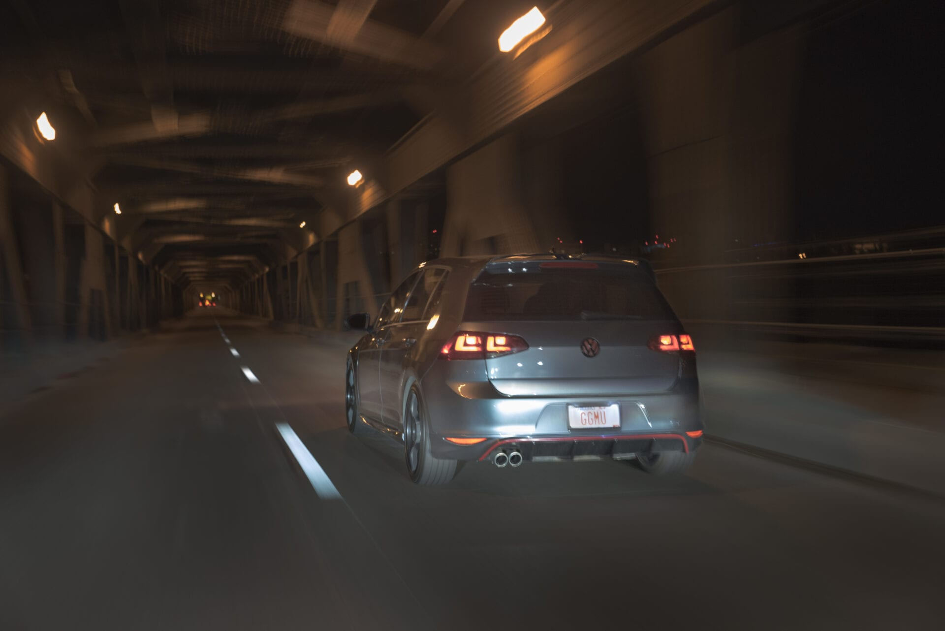 VW Golf zooming pass a car at the high level bridge