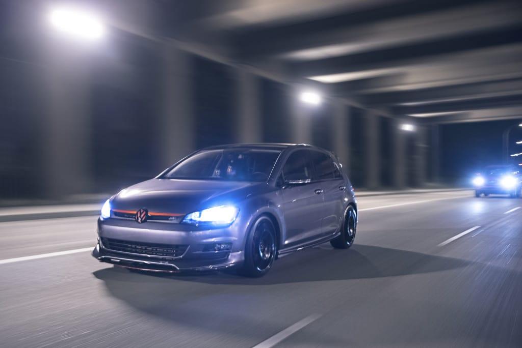 VW Golf driving under a bridge at fox drive in Edmonton at night