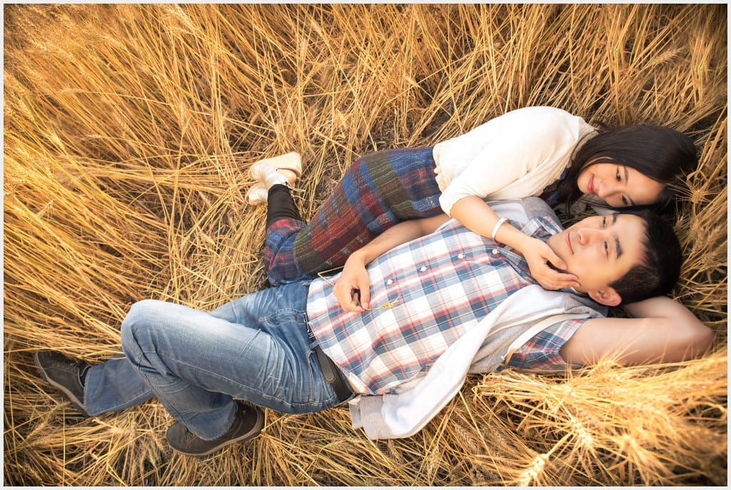 Couple laying on a field