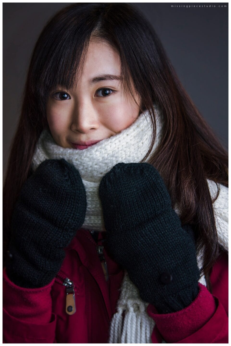 Girl with scarf in red jacket and a mitten