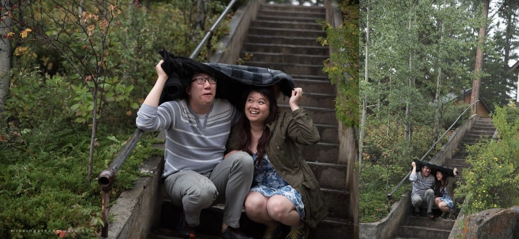 A couple hiding from the rain at a staircase in Johnston Canyon in the Banff National Park.