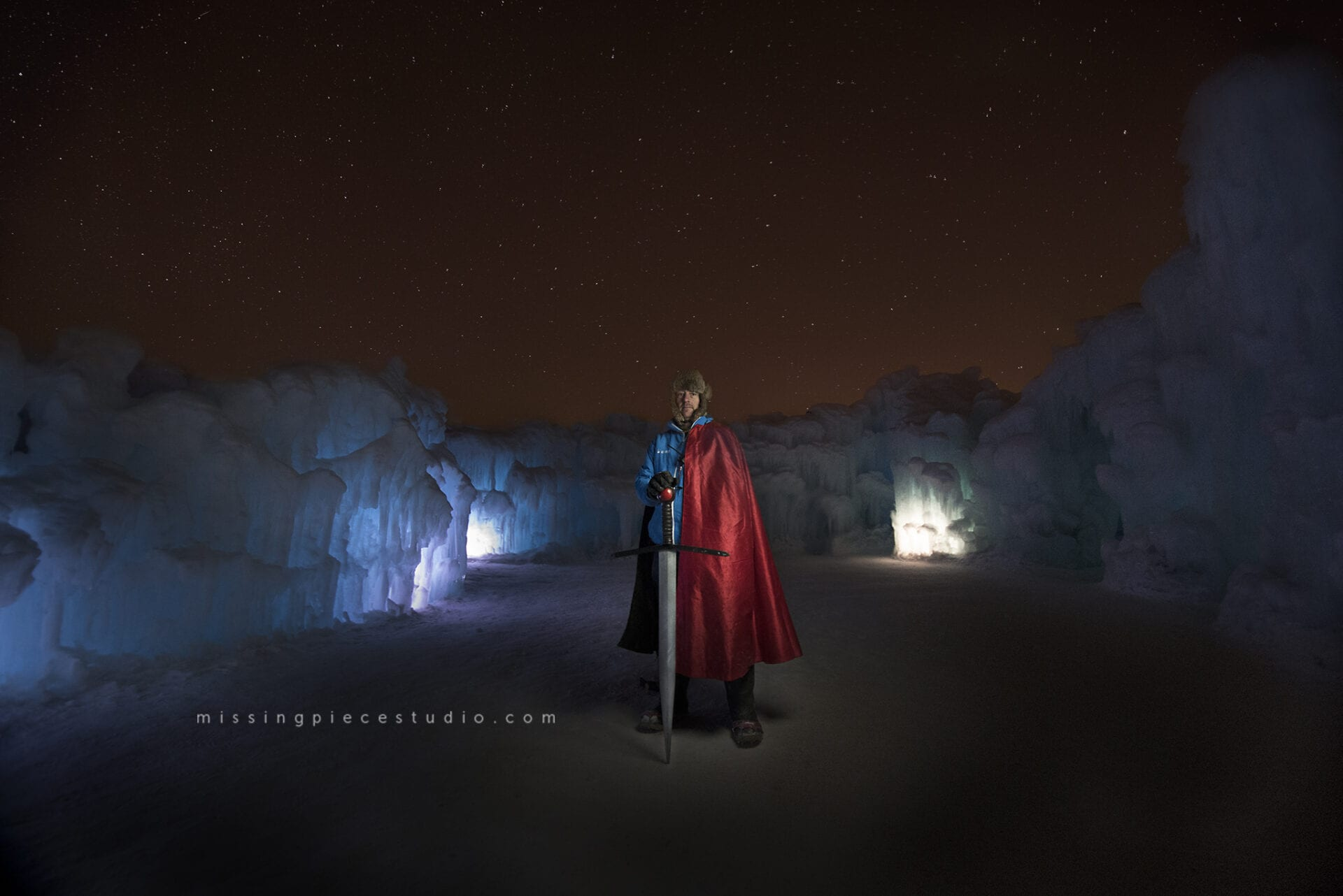 Ice castles staff dresses up as superman at the ice slide