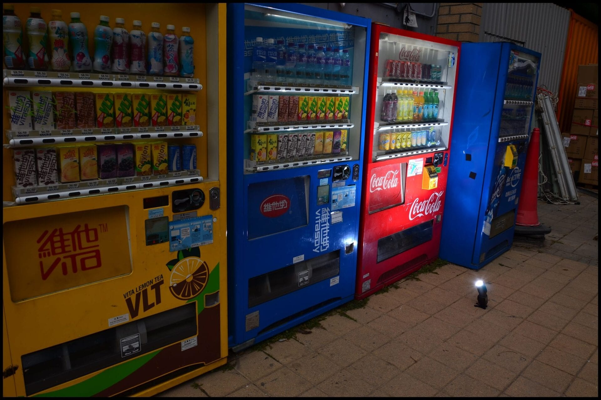 a row of vending machine lit by a nikon sb700 speedlight