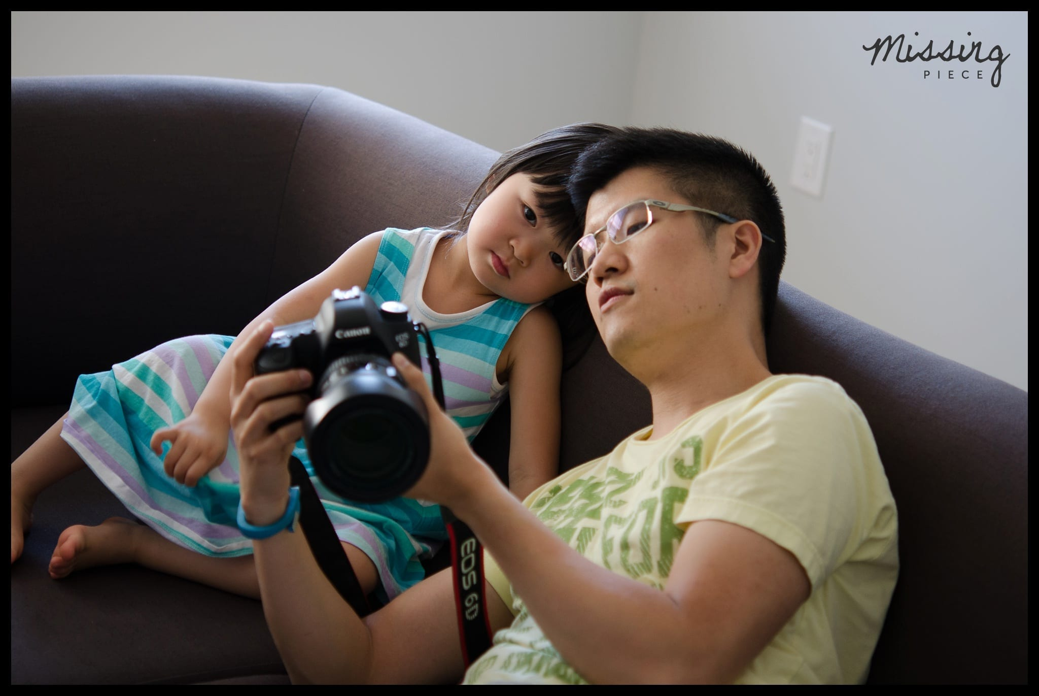 man showing him photos on his dSLR to his niece
