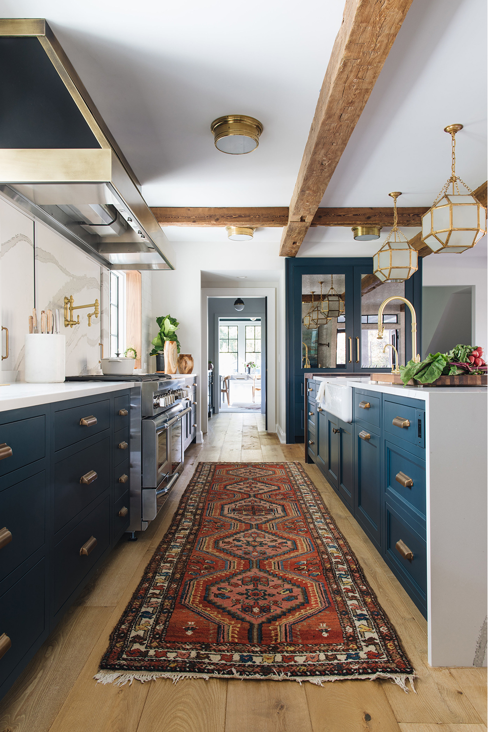 Blue Cupboards in a Kitchen Designed by Jean Stoffer