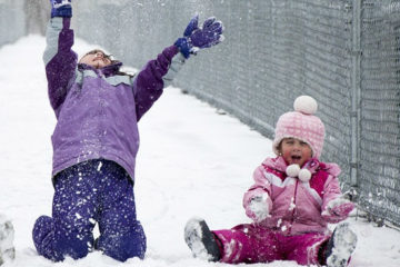 3 kids playing in snow