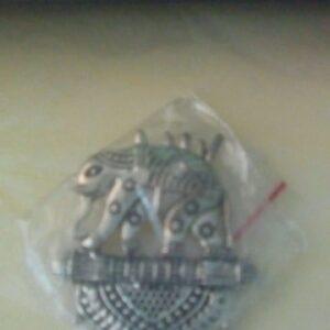 Antique silver elephant pendant