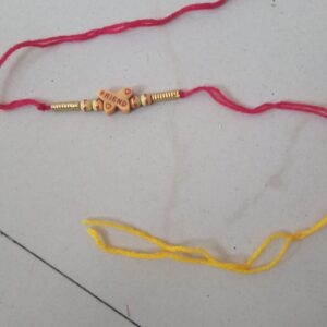 Red and yellow friendship band or rakhi