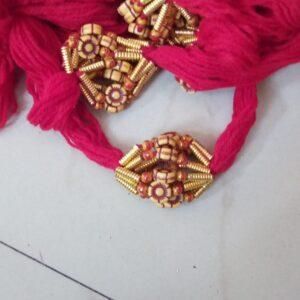 Red thread flower rakhi