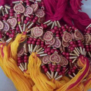 Red and yellow heart shape bead rakhi