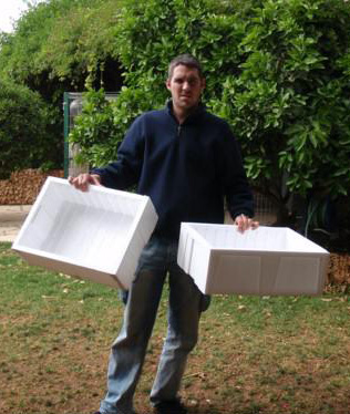 Joel with two Styrofoam boxes