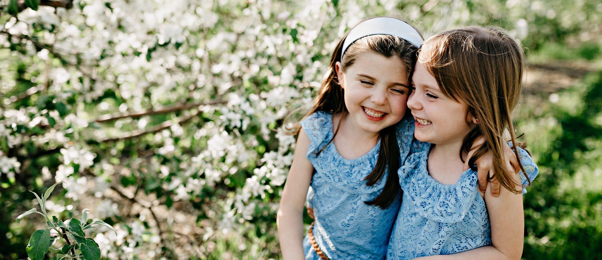 girls smiling and hugging