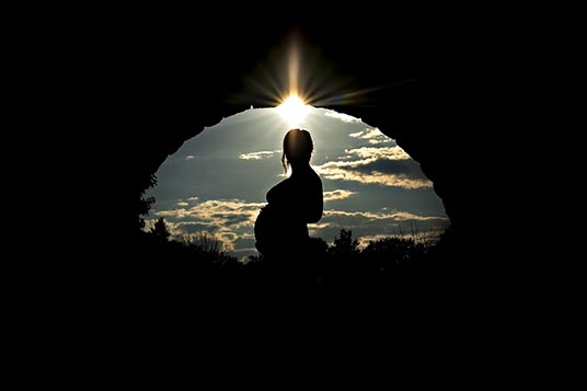 silhouetted pregnant woman