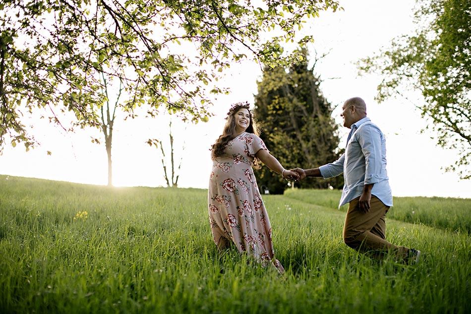 pregnant couple in field