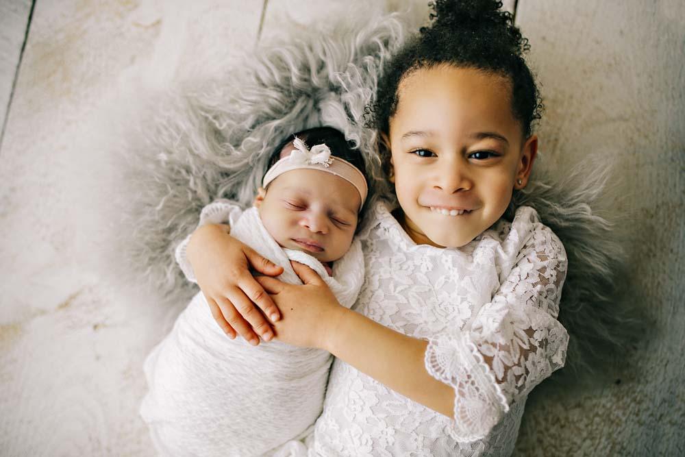 newborn with girl