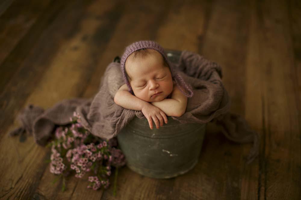 new born in purple