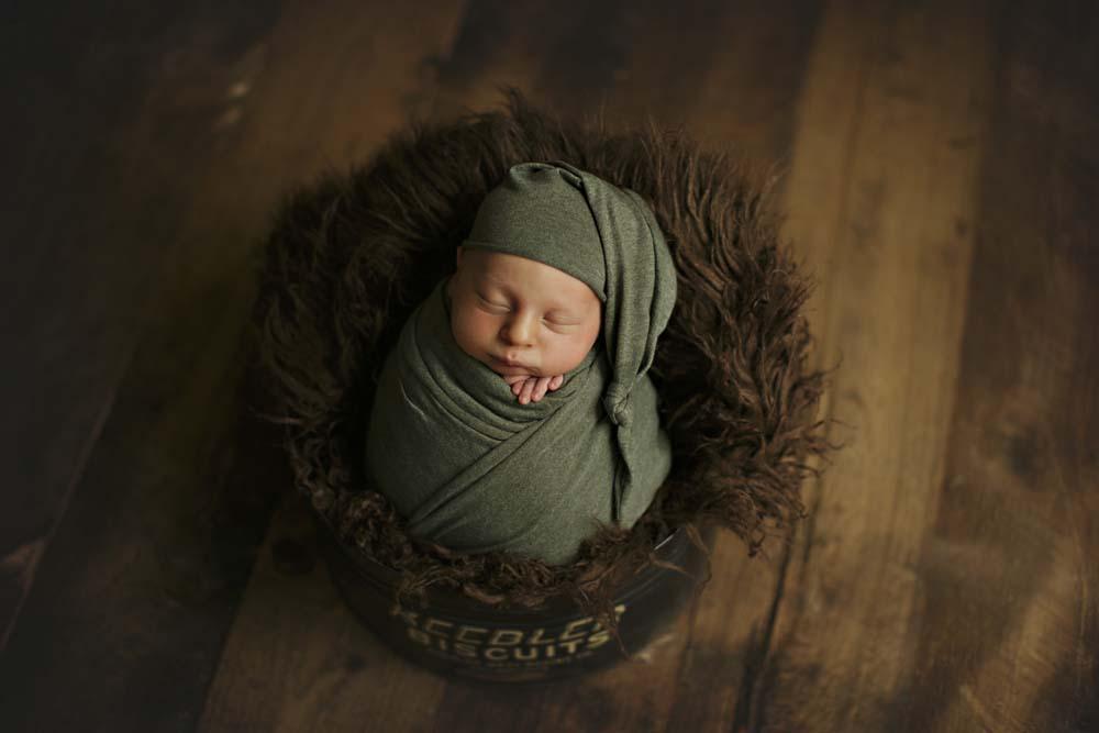 newborn in green