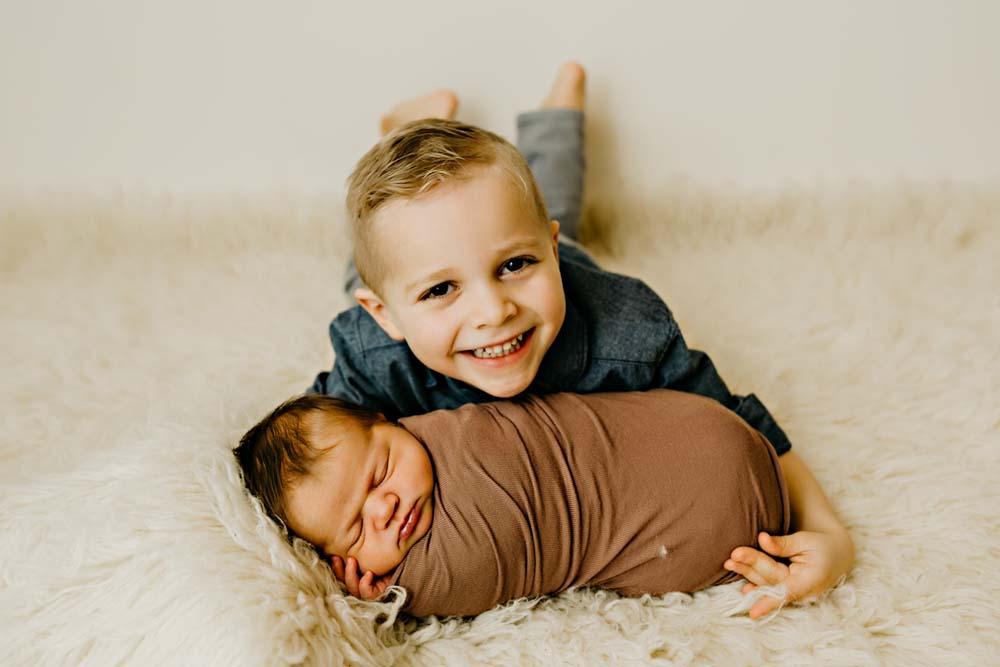 newborn in brown with boy