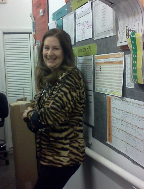 BEFORE: At the store with loads of goal charts and, yes, that animal print jacket!