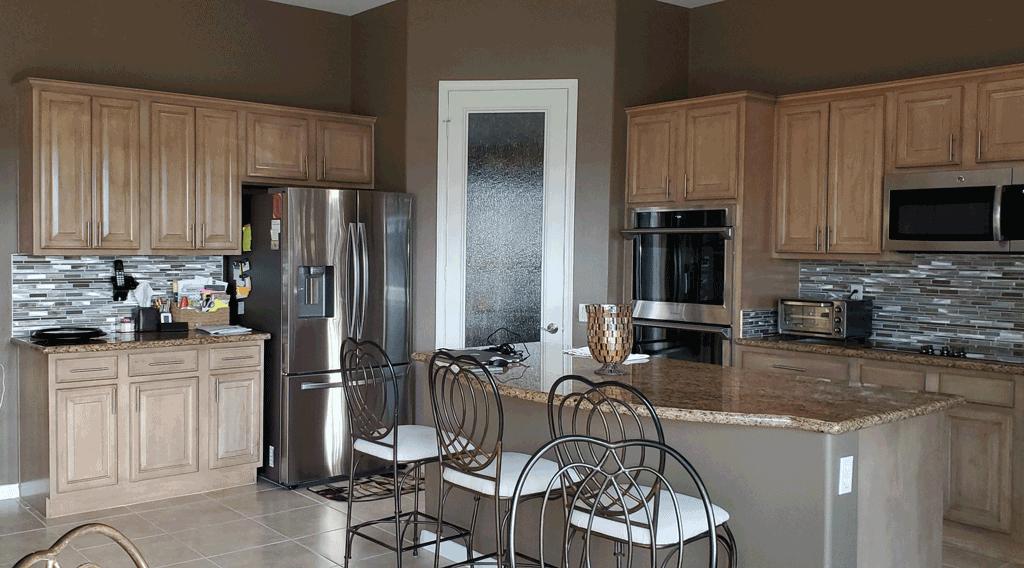 Wall Color Compliments Cabinetry & Flooring, Enhances Backsplash