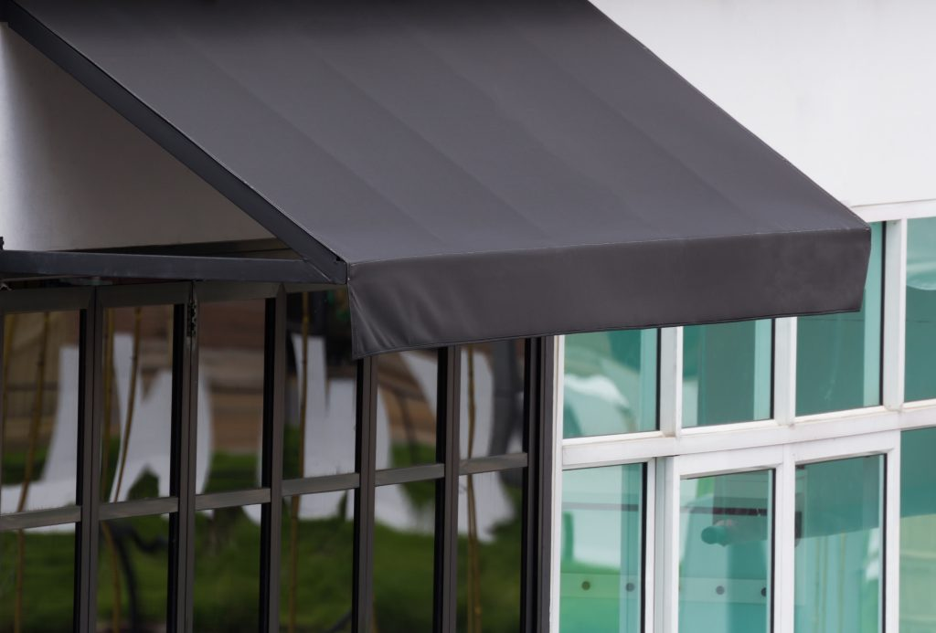 black retractable awnings on nyc business