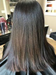 smoothing treatment at the salon after brunette