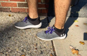 Grey shoes with purple laces