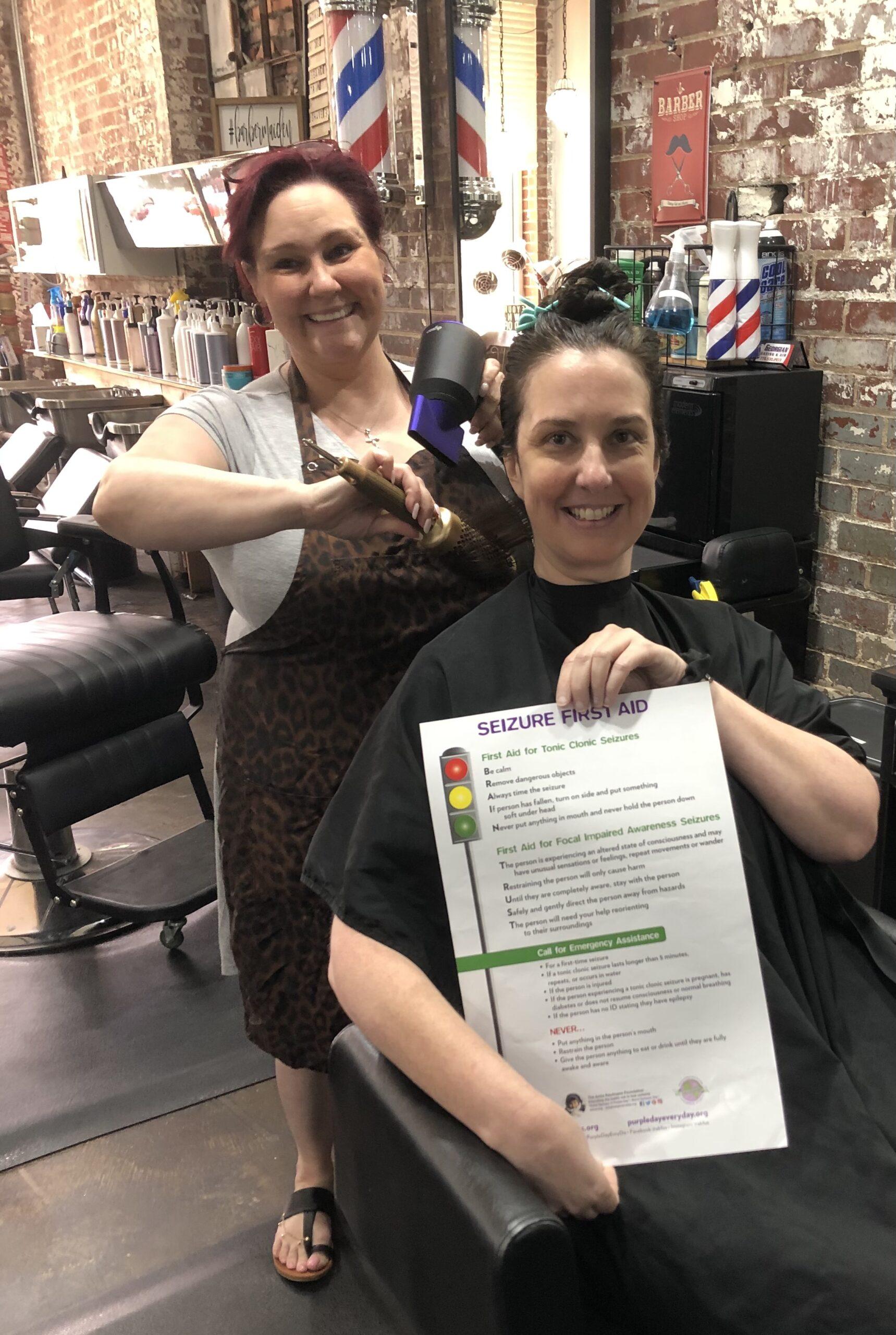 Woman sitting on chair in hair salon