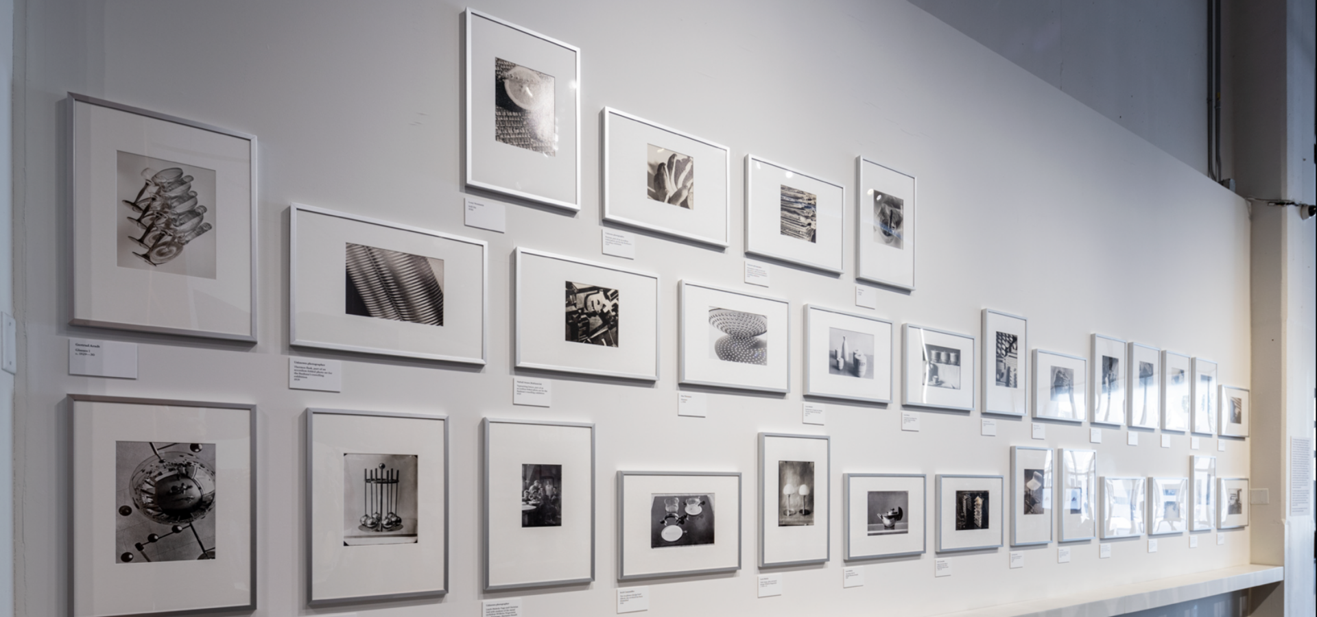 Black and white photos hung on a wall