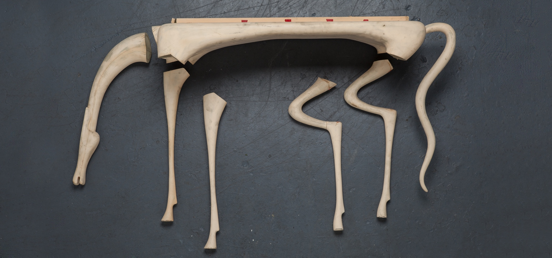 Disassembled sculpture of a long-legged animal