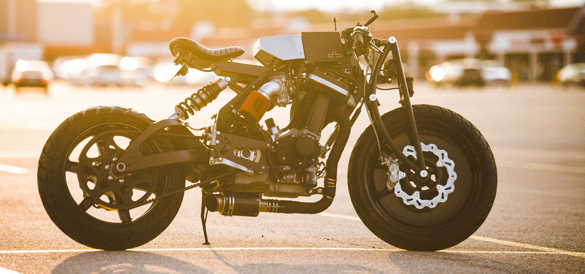Motorcycle on asphalt with sun in the back