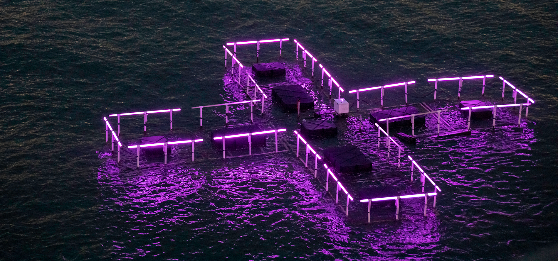 Purple 3D floating cross on the river