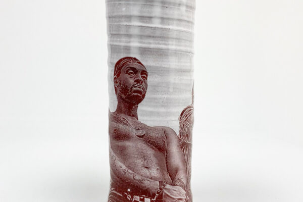 Cream cylindrical vases with impressed sepia photographs on their surface.