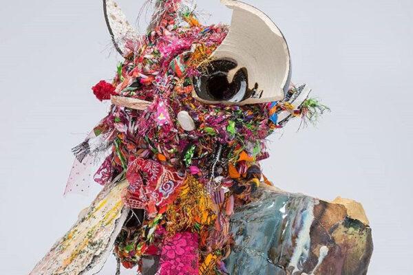Mixed media sculpture of fabric scraps and ceramic shards.