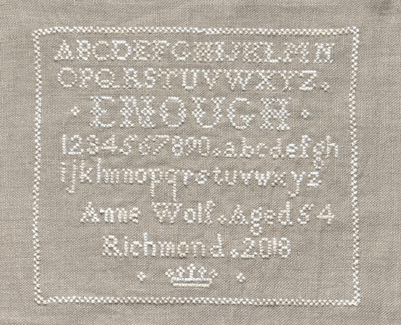 Stitched wording on linen