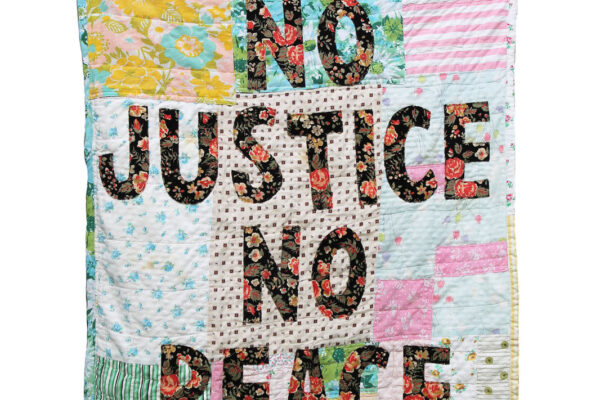 Quilt that says No Justice No Peace