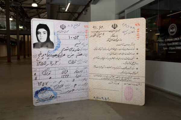 A large free-standing replica of a passport.