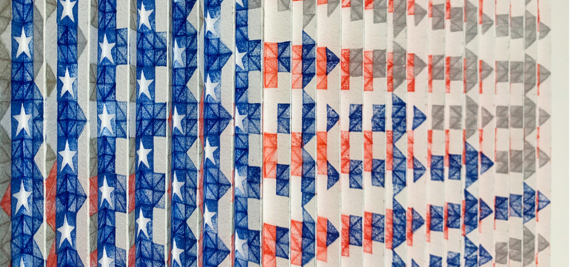 A series of folded and stamped papers that collectively make up the American flag.