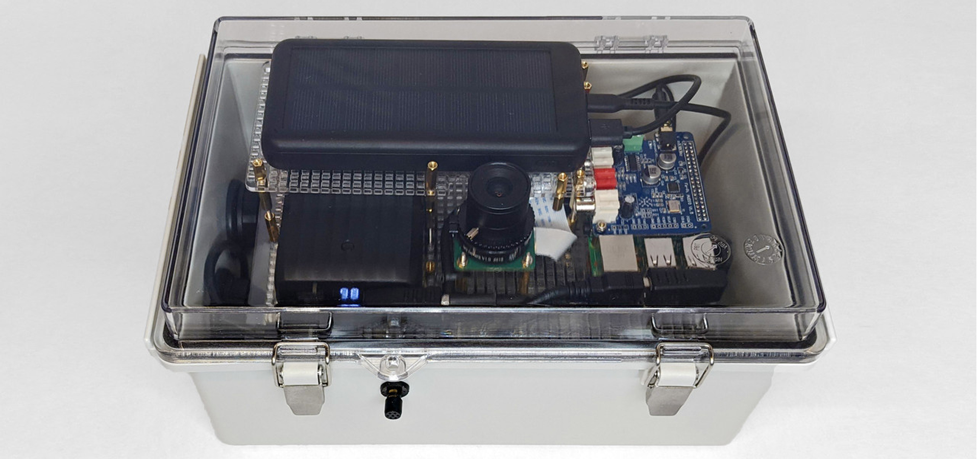 A clear plasic box containing electronics and a solar cell.